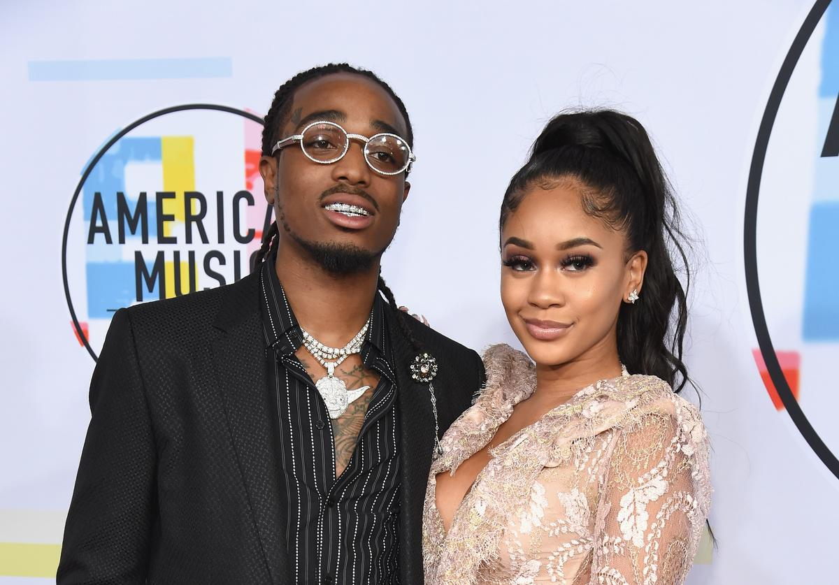 Quavo of Migos (L) and Saweetie attend the 2018 American Music Awards at Microsoft Theater on October 9, 2018 in Los Angeles, California