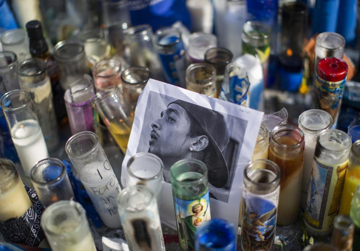 A photo of rapper Nipsey Hussle, 33, is seen among candles as people gather to mourn him on April 1, 2019 in Los Angeles, California