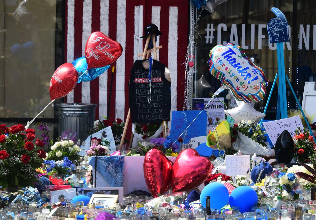 A makeshift memorial for Grammy-nominated rapper Nipsey Hussle sits in the parking lot in front of his Marathon Store in Los Angeles, California on April 2, 2019