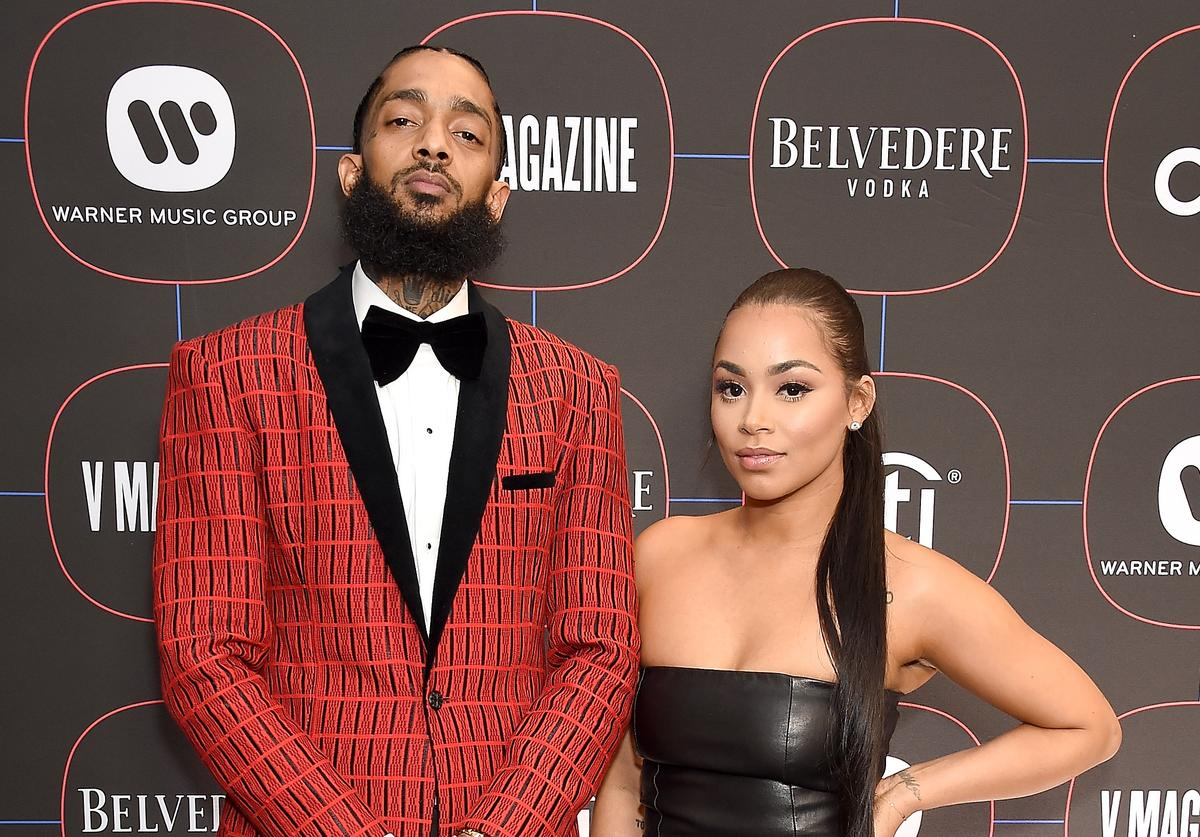 Nipsey Hussle and Lauren London arrive at the Warner Music Group Pre-Grammy Celebration at Nomad Hotel Los Angeles on February 7, 2019 in Los Angeles, California.