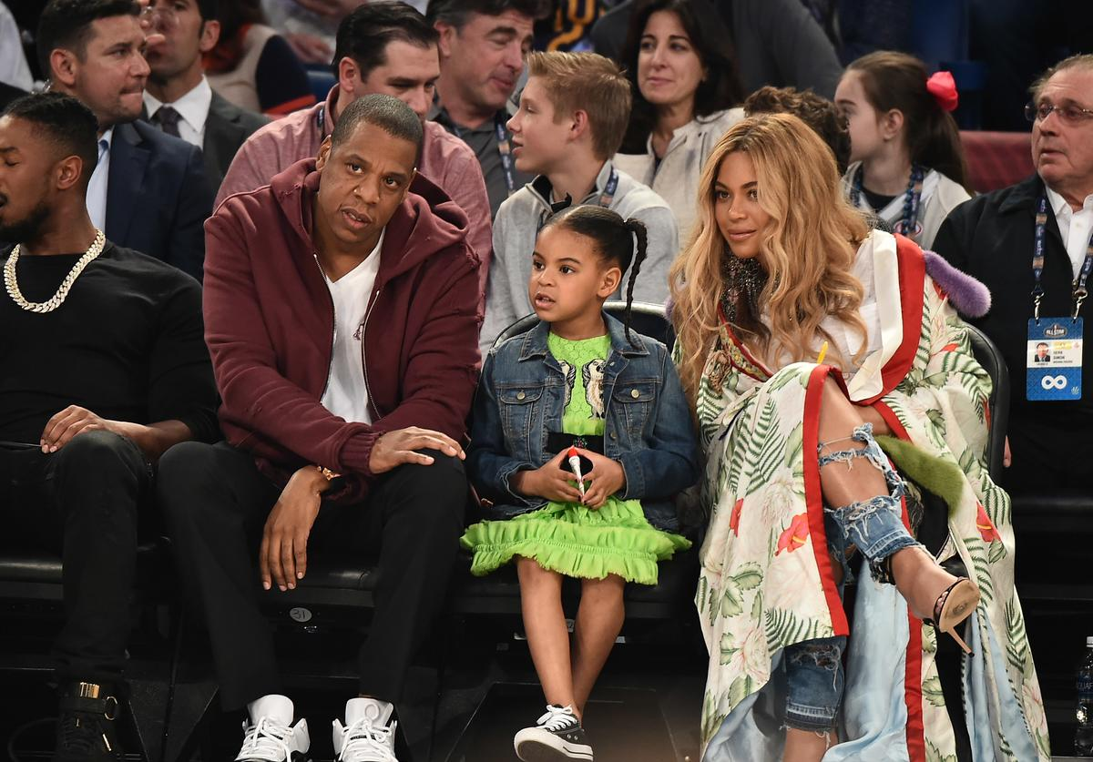 Jay Z, Blue Ivy Carter and Beyonce Knowles attend the 66th NBA All-Star Game at Smoothie King Center on February 19, 2017 in New Orleans, Louisiana