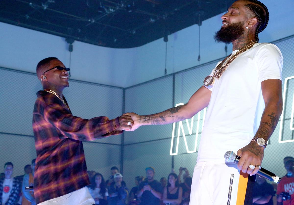 YG (L) and Nipsey Hussle perform during EA SPORTS NBA Live 19 at Goya Studios on August 24, 2018 in Los Angeles, California