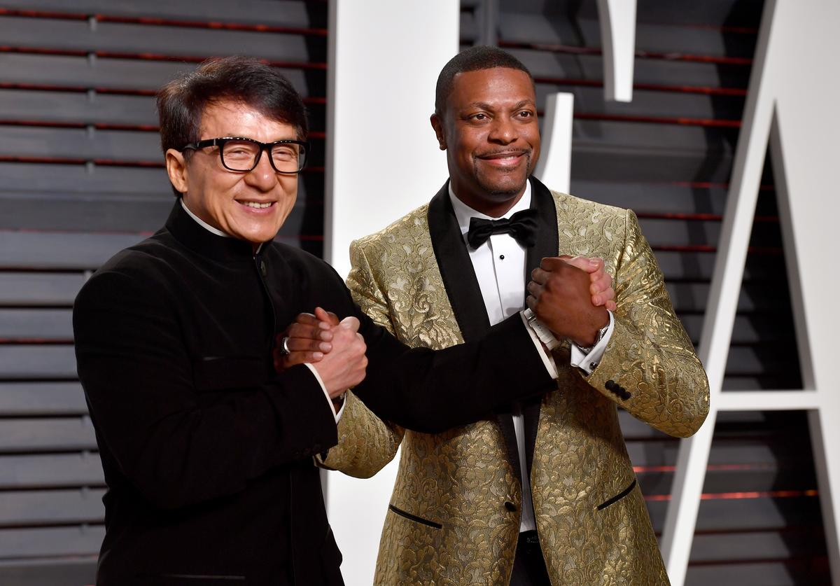 Actors Jackie Chan (L) and Chris Tucker attend the 2017 Vanity Fair Oscar Party hosted by Graydon Carter at Wallis Annenberg Center for the Performing Arts on February 26, 2017 in Beverly Hills, California.