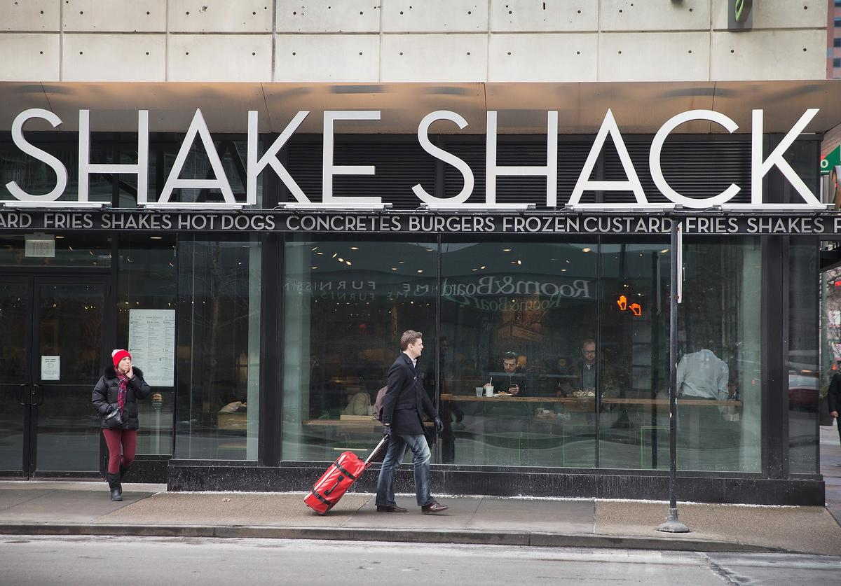 A sign hangs over the entrance of a Shake Shack restaurant on January 28, 2015 in Chicago, Illinois