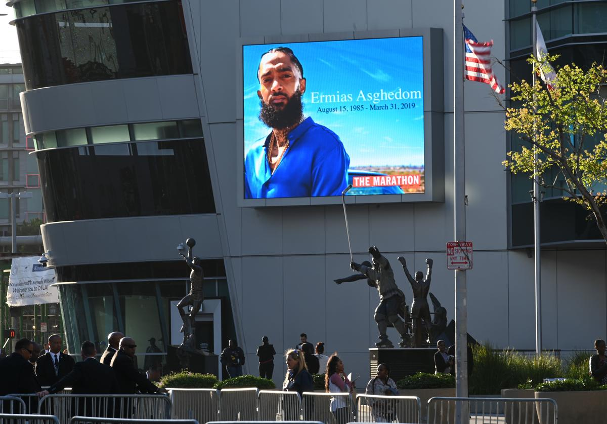 People arrive to attend the Celebration of Life memorial service for rapper recording artist and social activist Nipsey Hussle, April 11, 2019 at the Staples Center in Los Angeles, California