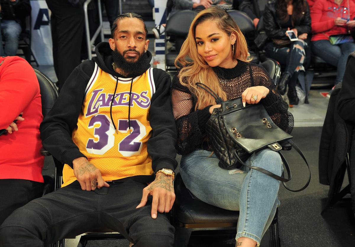 Rapper Nipsey Hussle and Lauren London attend a basketball game between the Los Angeles Lakers and the Minnesota Timberwolves at Staples Center on December 25, 2017 in Los Angeles, California.