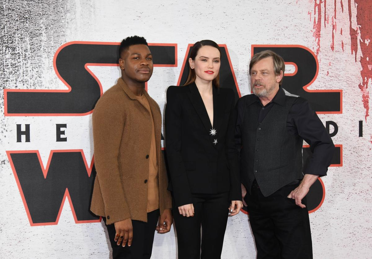 John Boyega, Daisy Ridley and Mark Hamill during the 'Star Wars: The Last Jedi' photocall at Corinthia Hotel London on December 13, 2017 in London, England.