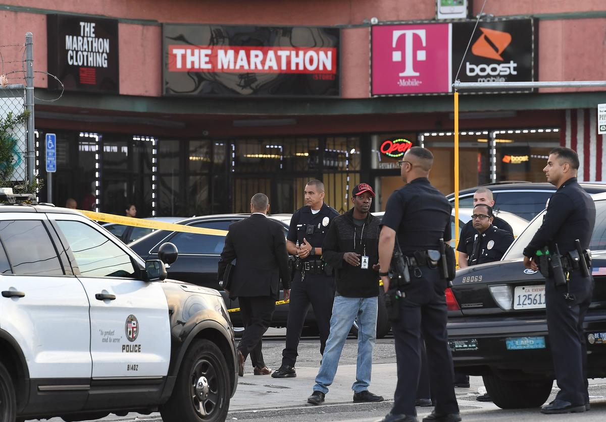 Police outside The Marathon clothing store owned by Grammy-nominated rapper Nipsey Hussle where he was fatally shot along with 2 other wounded, in Los Angeles on March 31, 2019