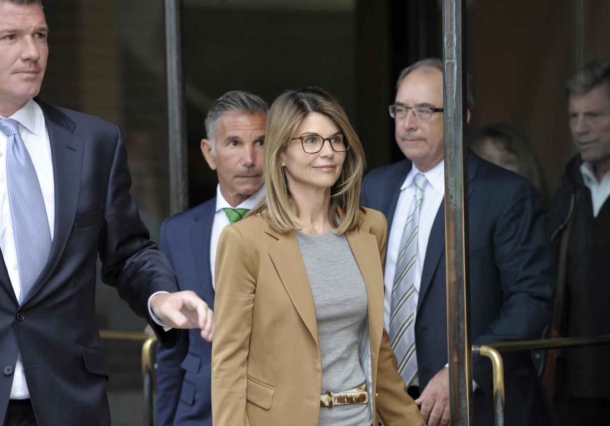Lori Loughlin exits the courthouse after facing charges for allegedly conspiring to commit mail fraud and other charges in the college admissions scandal at the John Joseph Moakley United States Courthouse in Boston on April 3, 2019