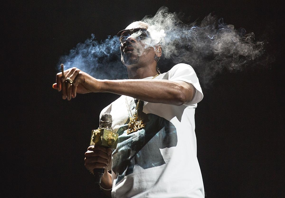 Snoop Dogg performs onstage during 'The High Road Tour' at Austin360 Amphitheater on August 21, 2016 in Austin, Texas