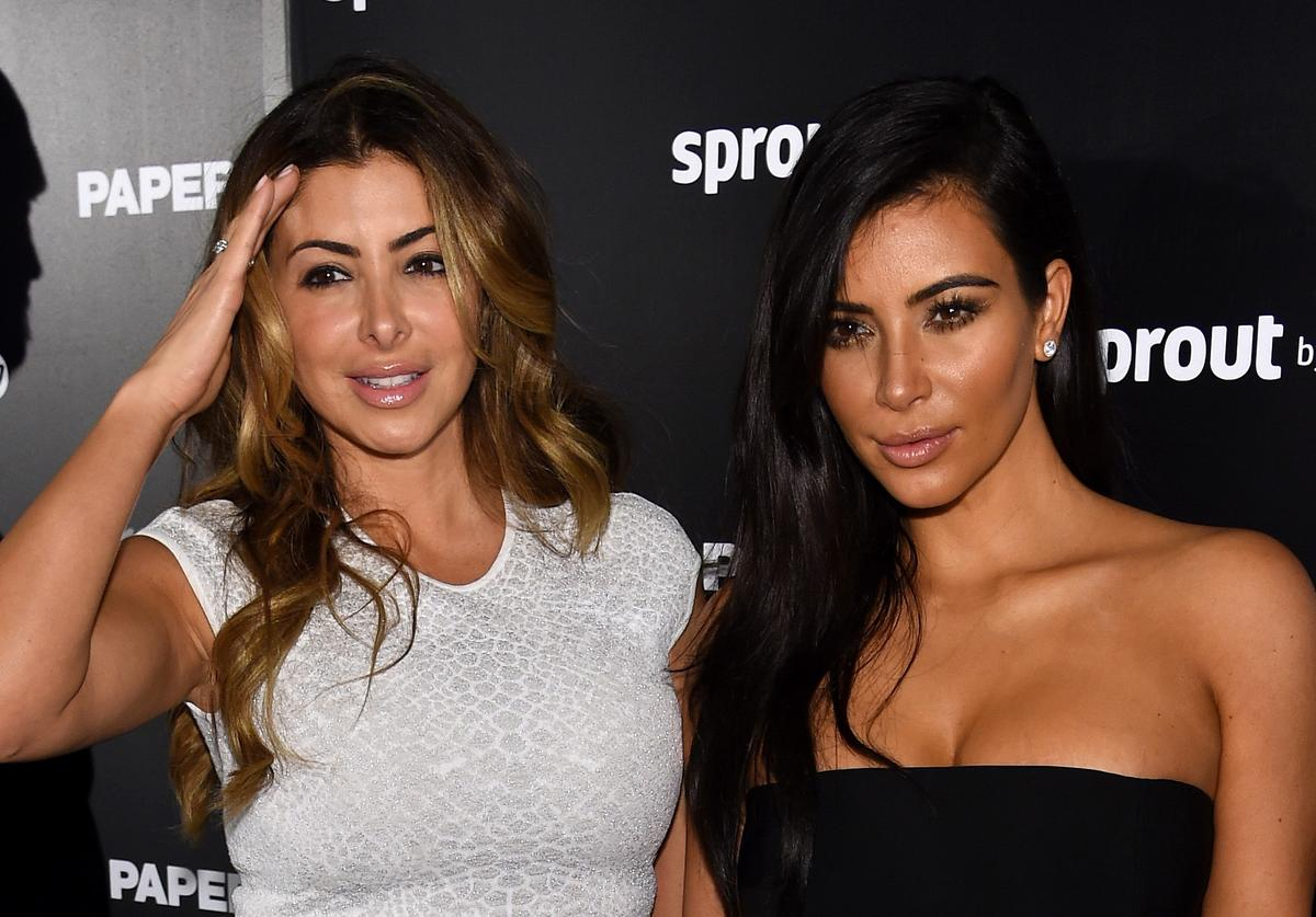 Larsa Pippen and Kim Kardashian on black carpet.