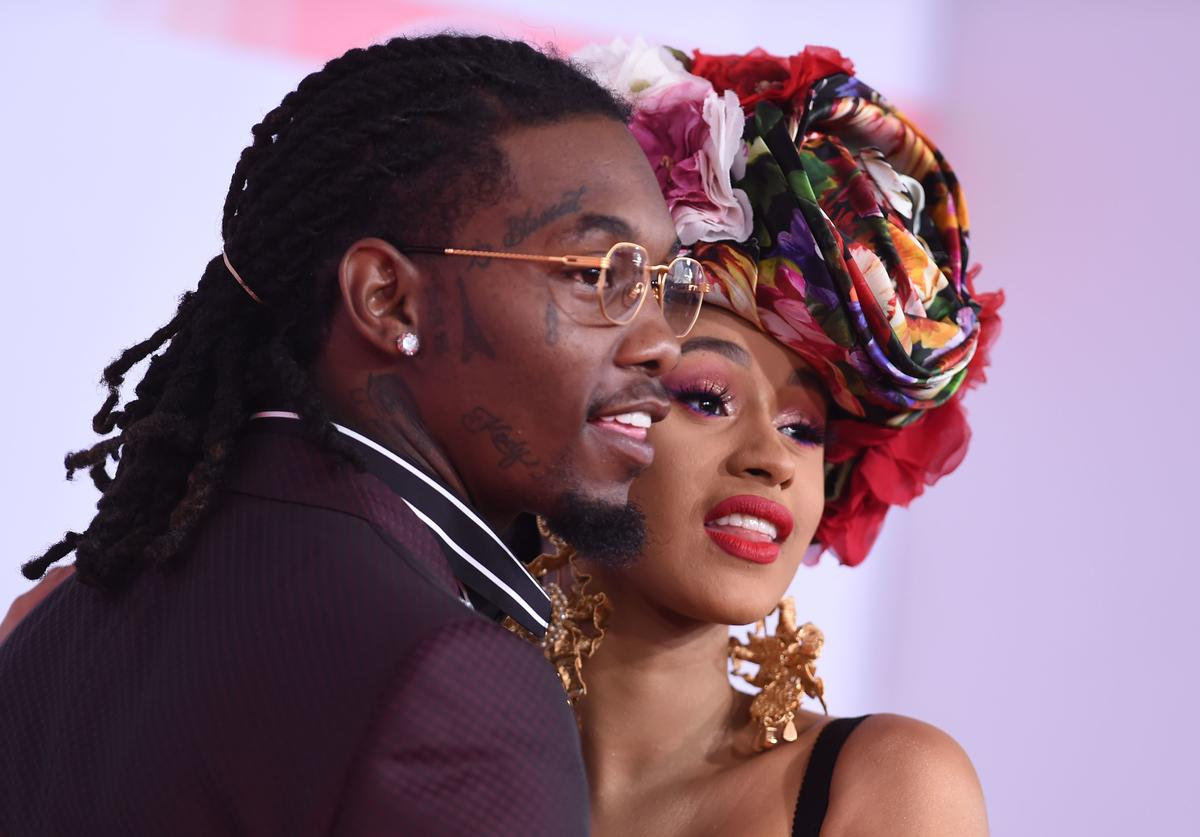 Cardi B (R) and US rapper Offset arrive at the 2018 American Music Awards on October 9, 2018, in Los Angeles, California