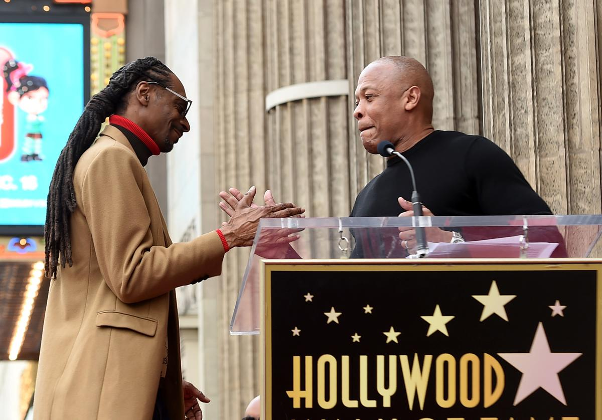 Snoop Dogg, with Dr. Dre (R) is honored with a star on The Hollywood Walk Of Fame on Hollywood Boulevard on November 19, 2018 in Los Angeles, California