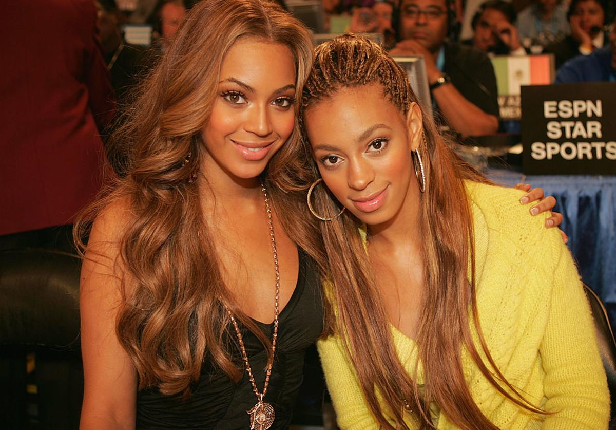 Beyonce and Solange pose together at the 2005 NBA All Star Game at the Pepsi Center on February 20, 2005 in Denver, Colorado.