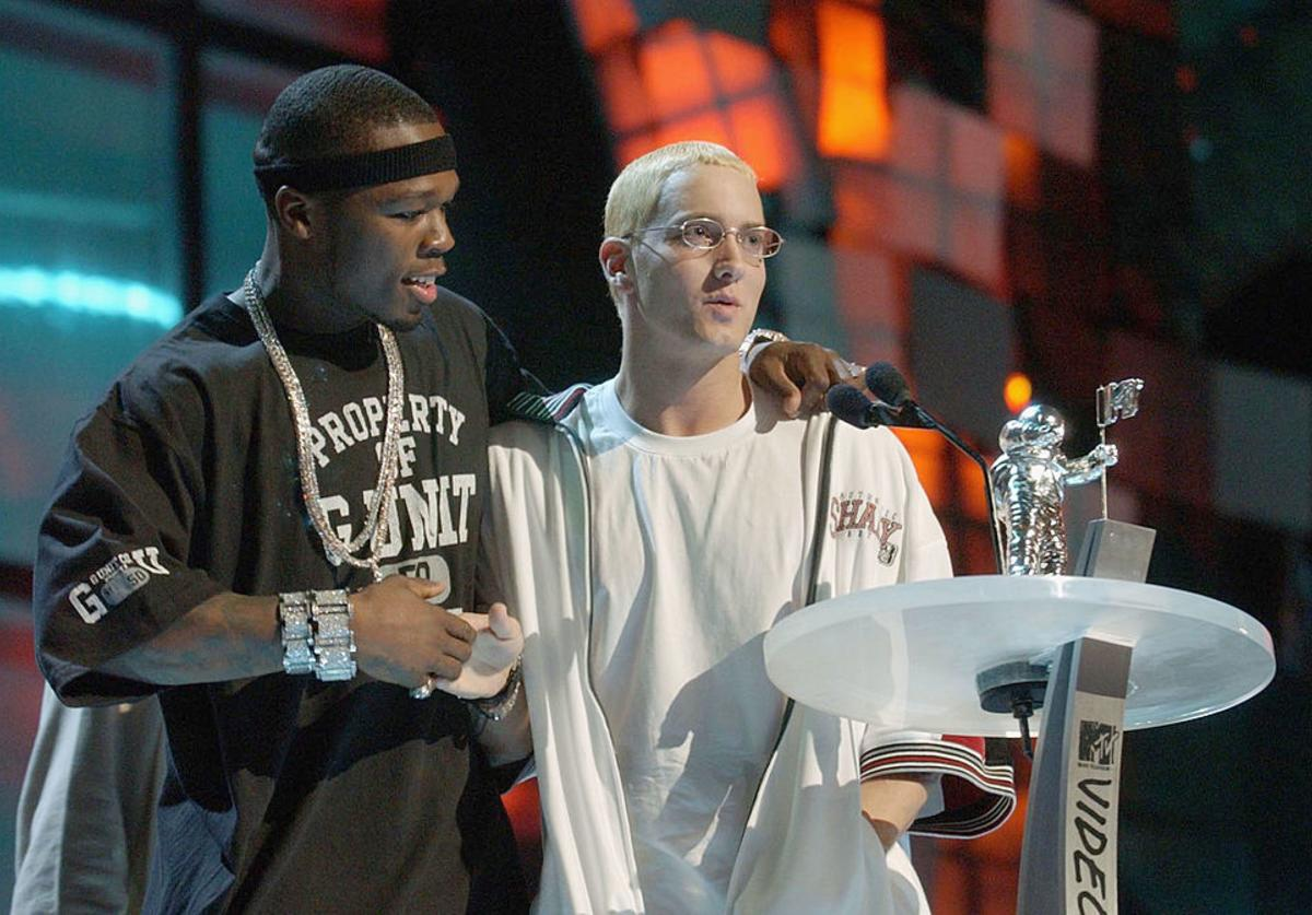 50 Cent (L) congratulates Eminem for receiving the award for Best Video From A Film during the 2003 MTV Video Music Awards at Radio City Music Hall on August 28, 2003 in New York City.