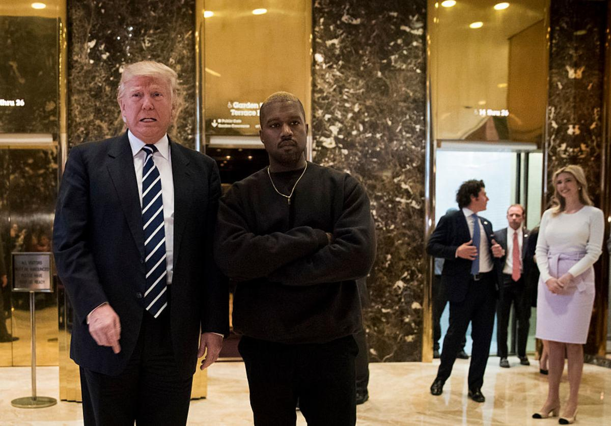 President-elect Donald Trump and Kanye West stand together in the lobby at Trump Tower, December 13, 2016 in New York City.