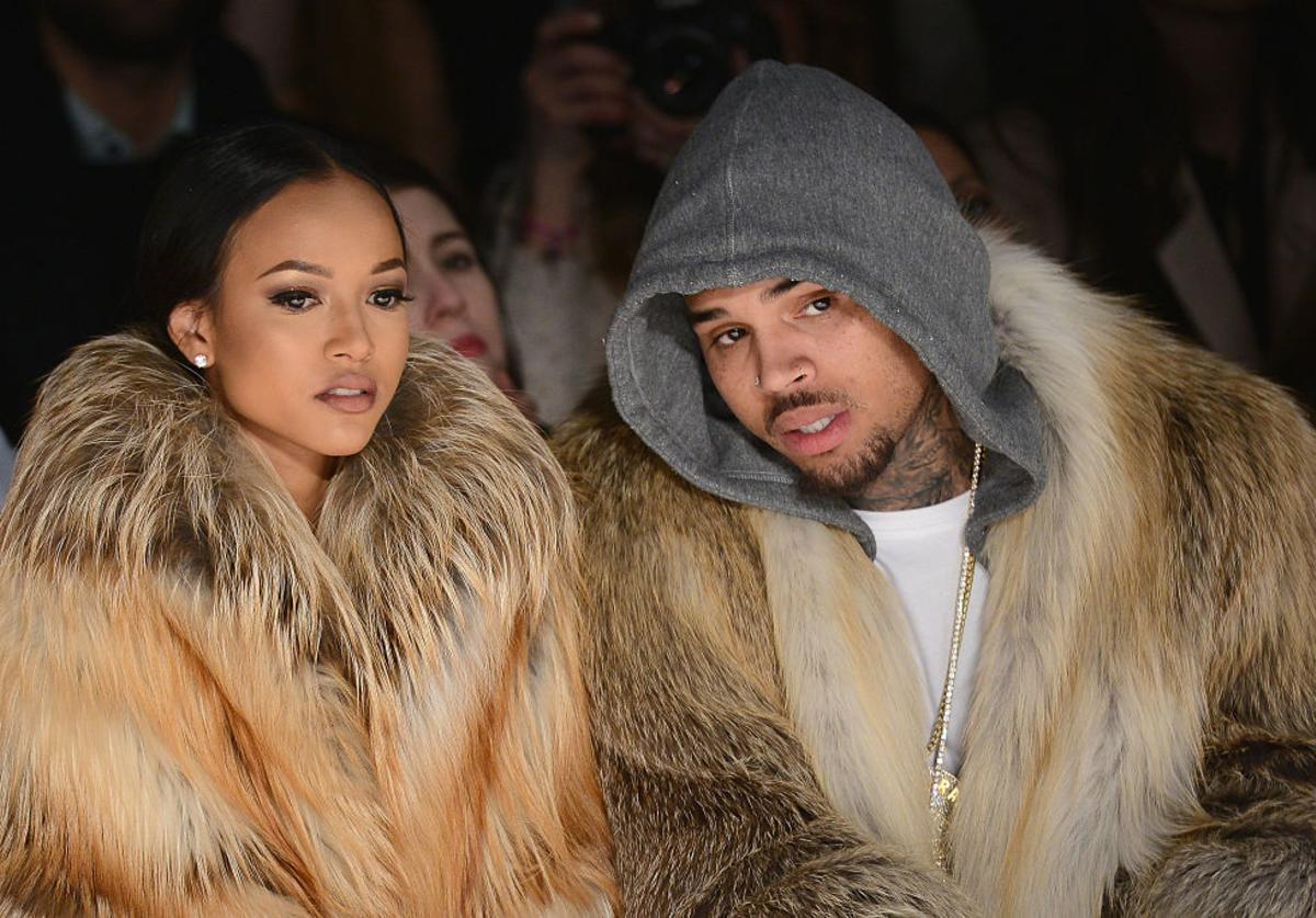 Karrueche Tran (L) and Chris Brown attends the Michael Costello fashion show during Mercedes-Benz Fashion Week Fall 2015 at The Salon at Lincoln Center on February 17, 2015 in New York City.