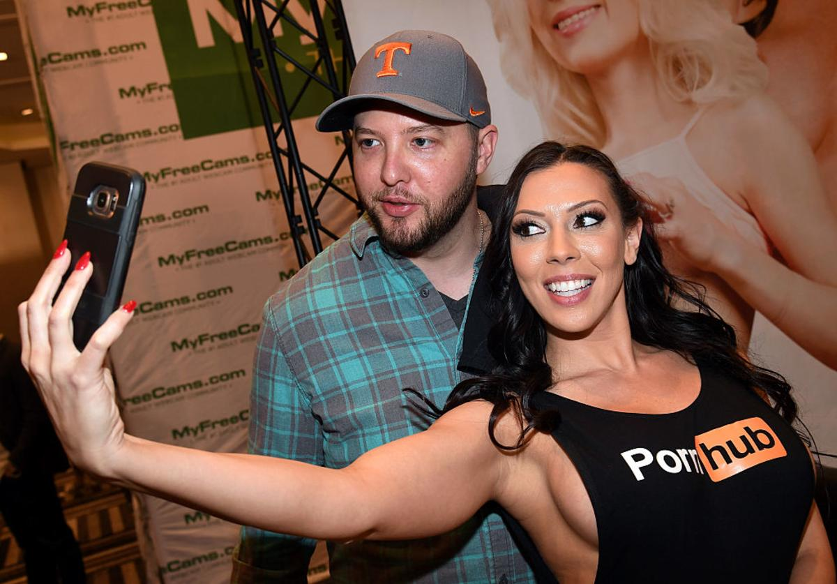 Daniel Thurman (L) of Tennessee takes a selfie with adult film actress Rachel Starr at the Pornhub booth at the 2017 AVN Adult Entertainment Expo at the Hard Rock Hotel & Casino on January 18, 2017 in Las Vegas, Nevada.