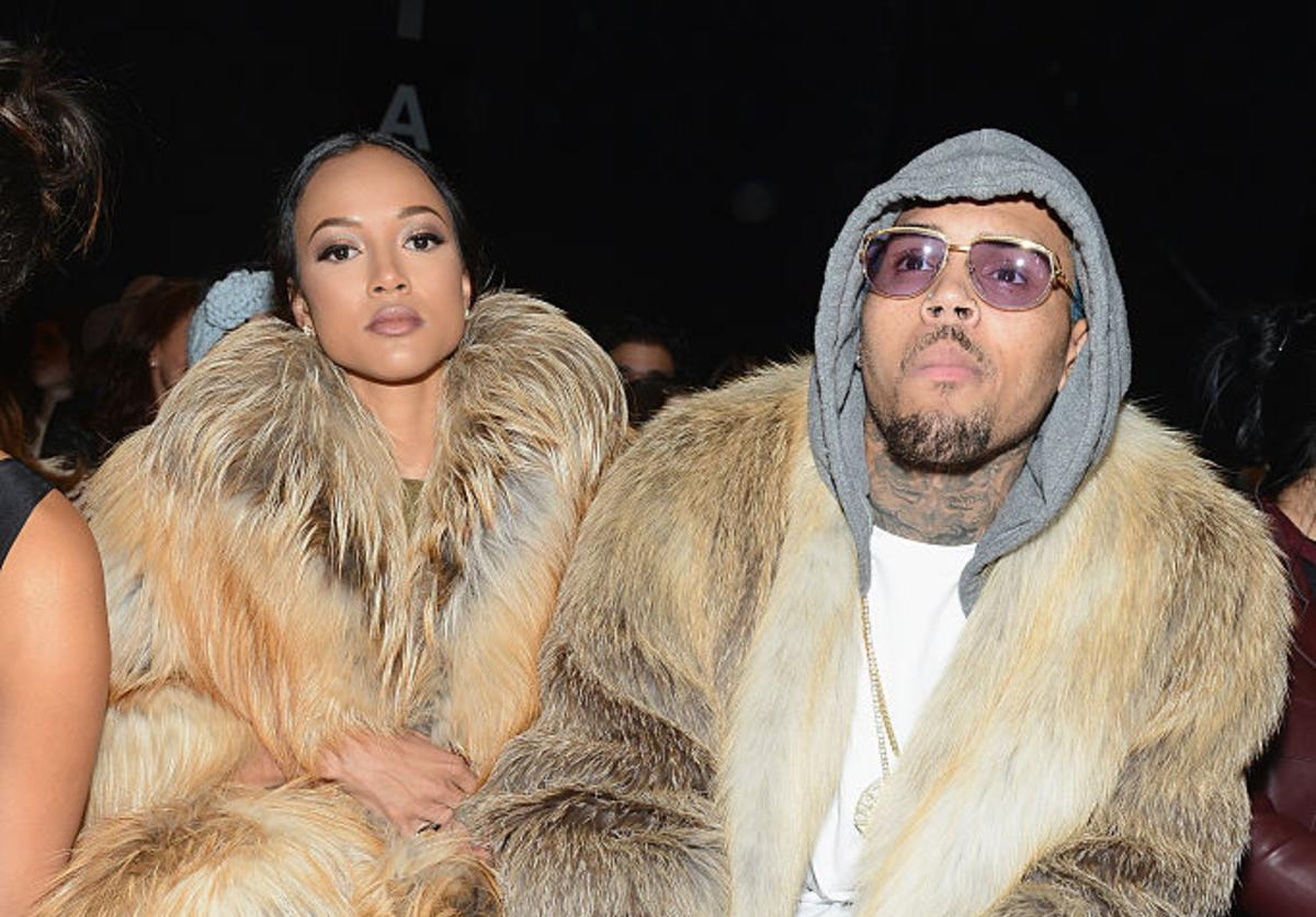 Karrueche Tran (L) and Chris Brown attend the Michael Costello fashion show during Mercedes-Benz Fashion Week Fall 2015 at The Salon at Lincoln Center on February 17, 2015 in New York City.