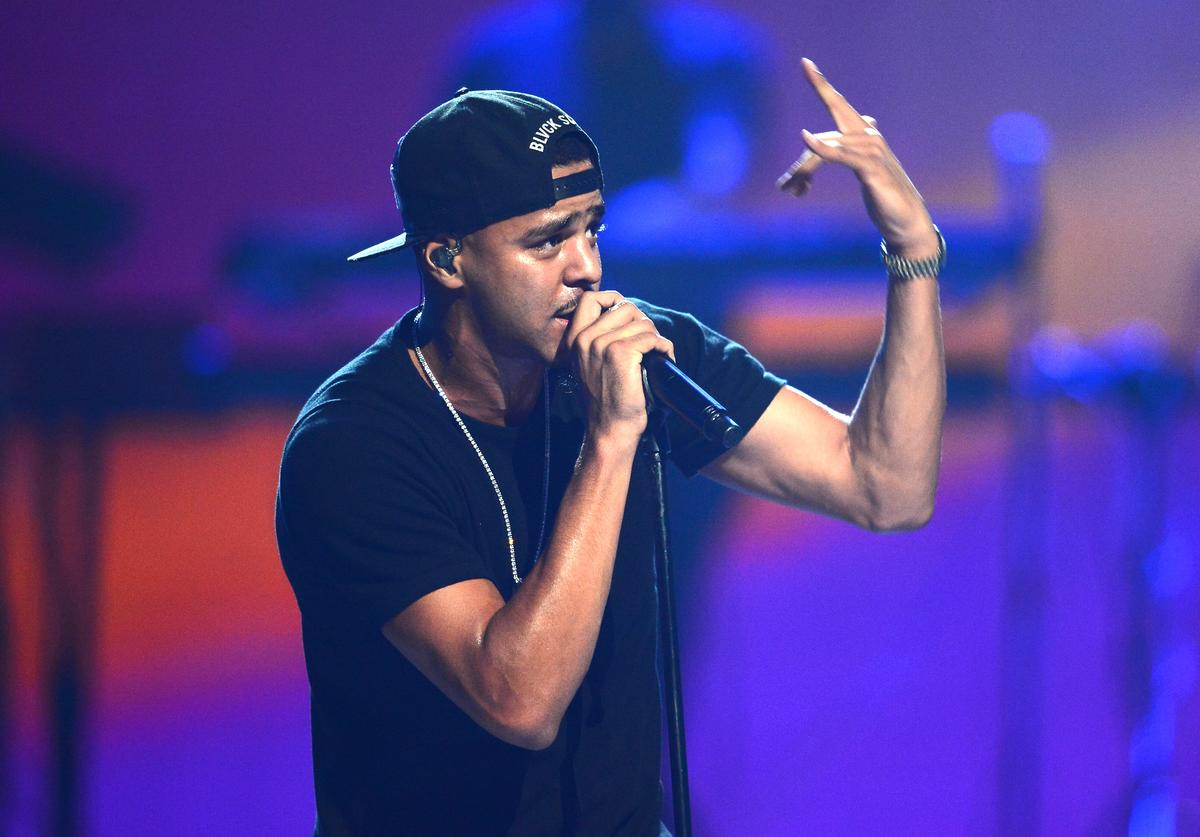 J. Cole performs onstage during the iHeartRadio Music Festival at the MGM Grand Garden Arena