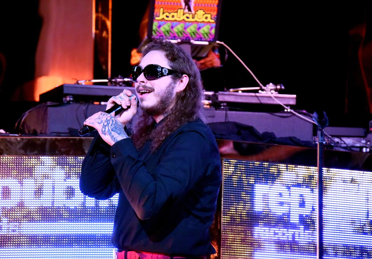 Post Malone performs onstage during the VMA after party hosted by Republic Records and Cadillac at TAO restaurant at the Dream Hotel on August 27, 2017 in Los Angeles, California.