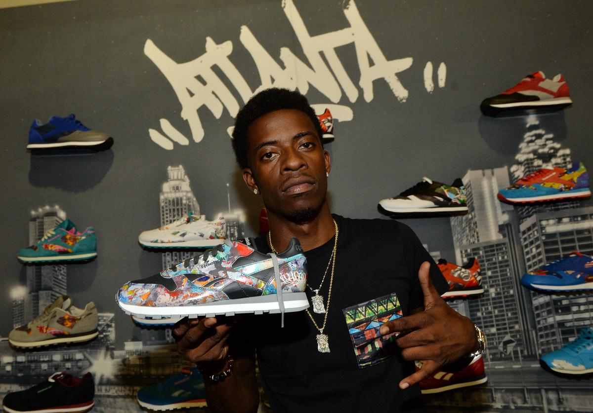Rich Homie Quam visits the Reebox Hospitality Lounge backstage during the 18th. annual HOT 107.9 Birthday Bash at Philips Arena on June 15, 2013 in Atlanta, Georgia.