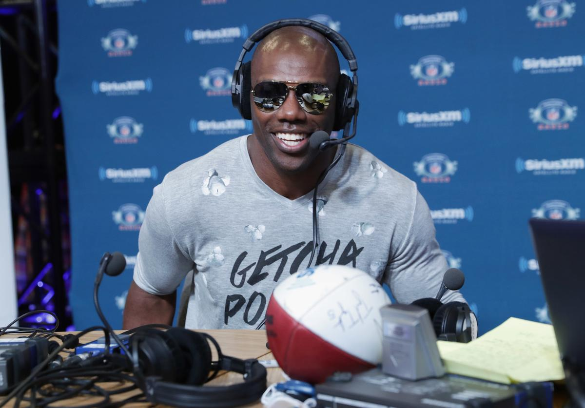 Former NFL player Terrell Owens visits the SiriusXM set at Super Bowl LI Radio Row at the George R. Brown Convention Center on February 3, 2017 in Houston, Texas