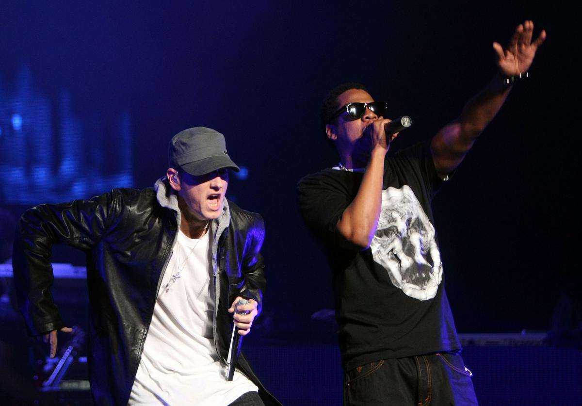 Jay-Z and Eminem perform together on-stage at the launch of 'DJ Hero' at the Wiltern Theatre on June 1, 2009 in Los Angeles, California