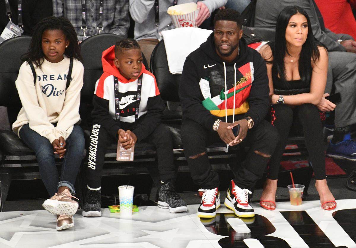 Kevin Hart, Eniko Parrish, Hendrix Hart and Heaven Hart attend The 67th NBA All-Star Game: Team LeBron Vs. Team Stephen at Staples Center on February 18, 2018 in Los Angeles, California