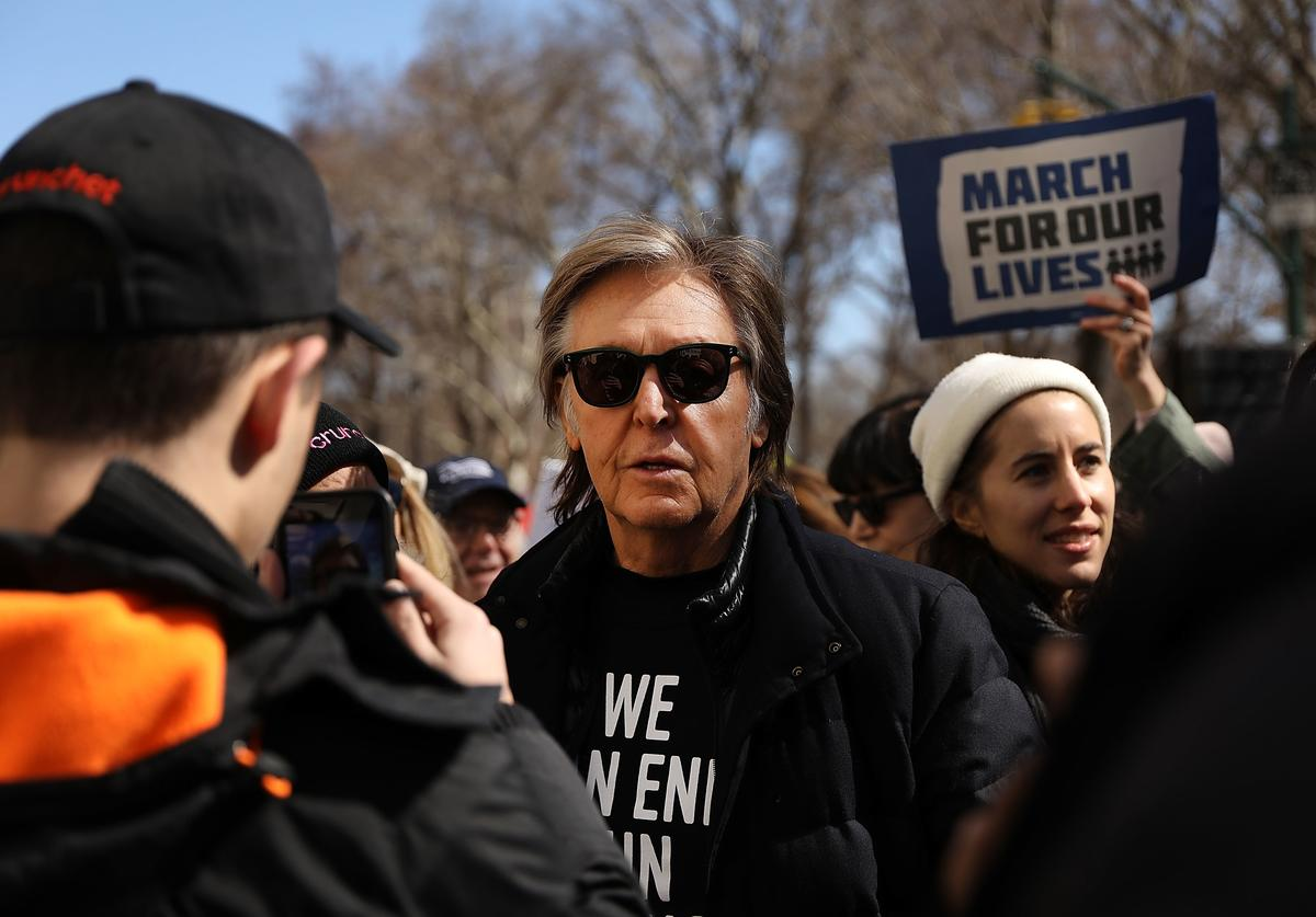 Sir Paul McCartney joins thousands of people, many of them students, march against gun violence in Manhattan during the March for Our Lives rally on March 24, 2018 in New York, United States. More than 800 March for Our Lives events, organized by survivors of the Parkland, Florida school shooting on February 14 that left 17 dead, are taking place around the world to call for legislative action to address school safety and gun violence.