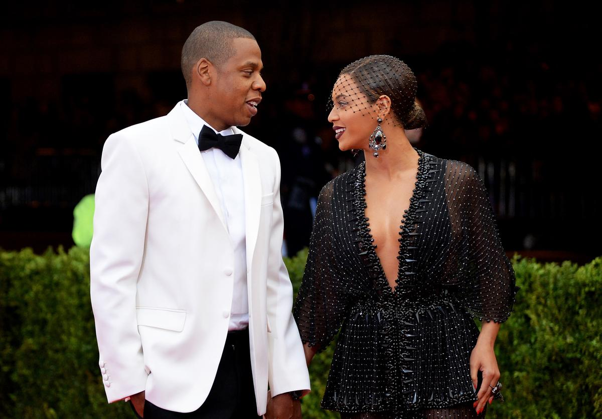 Jay-Z (L) and Beyonce attend the 'Charles James: Beyond Fashion' Costume Institute Gala at the Metropolitan Museum of Art on May 5, 2014 in New York City