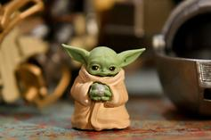 """Baby Yoda Rocks Out With Director Robert Rodriguez On """"The Mandalorian"""" Set"""