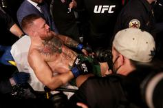 Conor McGregor Taken Off On Stretcher After Gruesome Leg Injury