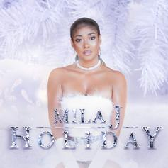 "Mila J Drops Off Christmas-Themed ""Holiday"" Project"
