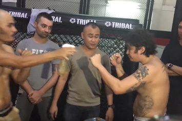 MMA Fighter Sprays His Opponent In The Face With A Bottle Of His Urine
