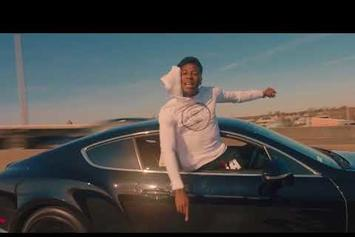"YoungBoy Never Broke Again Cruises Around In ""Diamond Teeth Samurai"" Video"