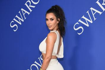 "Kim Kardashian Brushes Off ""Vibes Lawsuit"" By Balancing Perfume On Bare Bum"