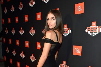Olivia Culpo Wears A Snake For Sports Illustrated Swimsuit Issue