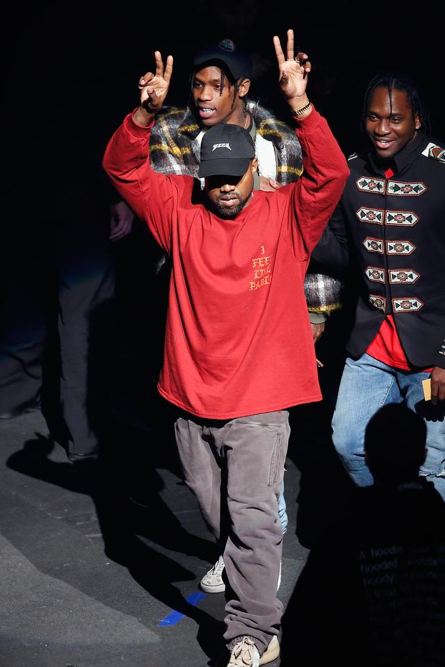 Kanye West giving peace signs at yeezy season 3 debut