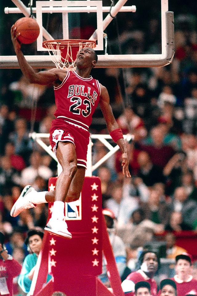 Michael Jordan #23 of the Chicago Bulls attempts a dunk during the 1988 Slam Dunk Contest on February 6, 1988 at the Chicago Stadium, Chicago, Illinois.