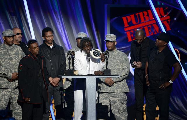 (L-R) Inductees Terminator X (2nd from L), Professor Griff, Hank Shocklee, Flavor Flav (C), Keith Shocklee, and Chuck D (R) of Public Enemy speak on stage at the 28th Annual Rock and Roll Hall of Fame Induction Ceremony at Nokia Theatre L.A. Live on April 18, 2013 in Los Angeles, California.