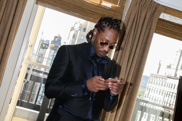 Future checking his phone