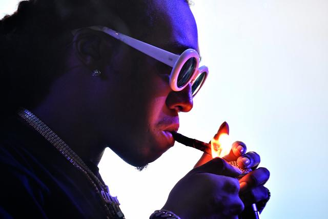 Takeoff lighting a blunt at Hangout Fest 2017