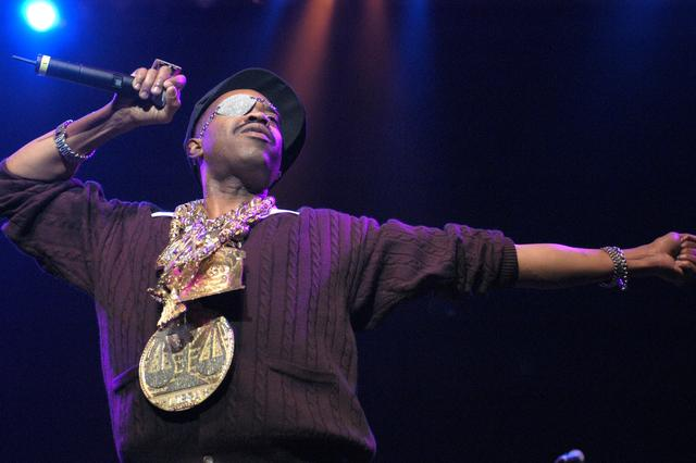 Slick Rick with his justice scale chain