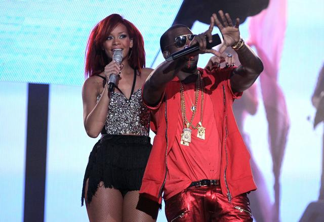 Rihanna and Kanye West throwing up the roc