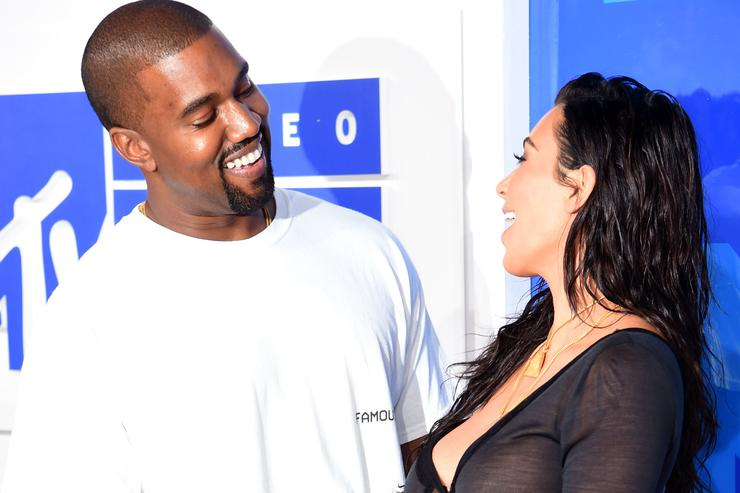 Kim Kardashian and Kanye West laughing together