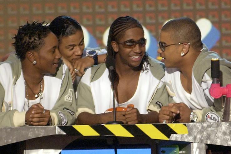 Members of the band B2K, winners of the Favorite Music Group award, deliver an acceptance speech