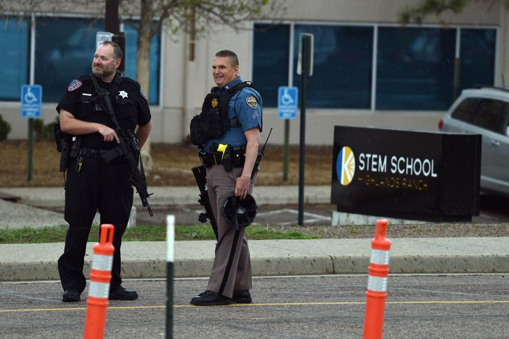 Police officers stand watch at the scene of a shooting in which at least seven students were injured at the STEM School Highlands Ranch on May 7, 2019 in Highlands Ranch, Colorado.