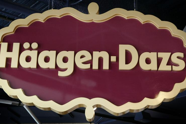 A sign marks the location of a Haagen-Dazs store February 19, 2003 in downtown Chicago