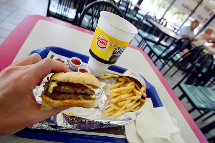 A double hamburger with a King Fries and a King size Coke is seen on July 18, 2002 at a Burger King in Miami, Florida.